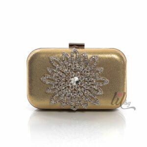 Златна чанта с цвете
